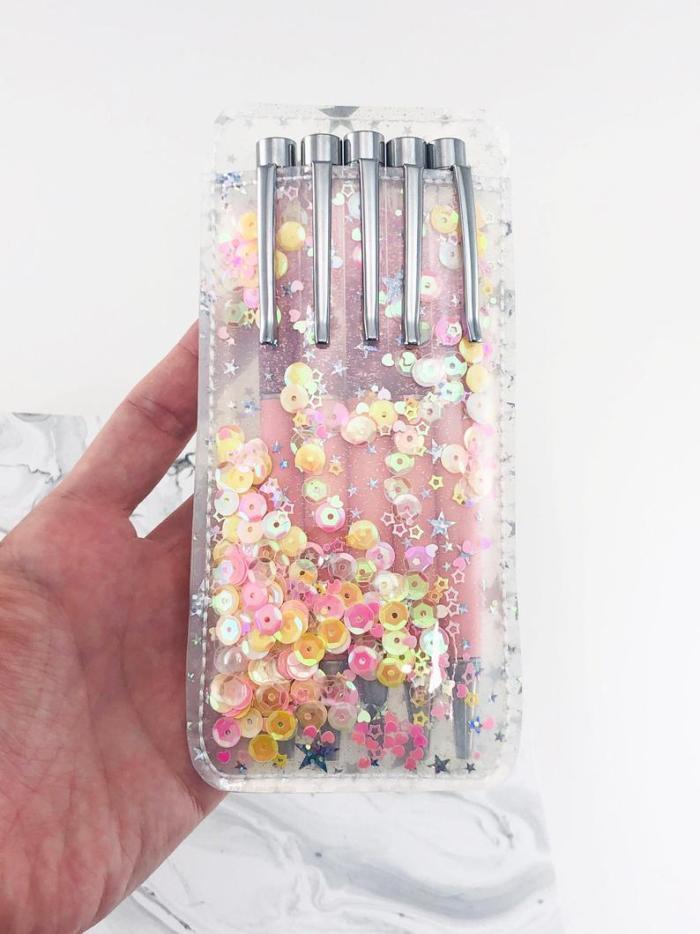 hand holding shaker pen holder sleeve