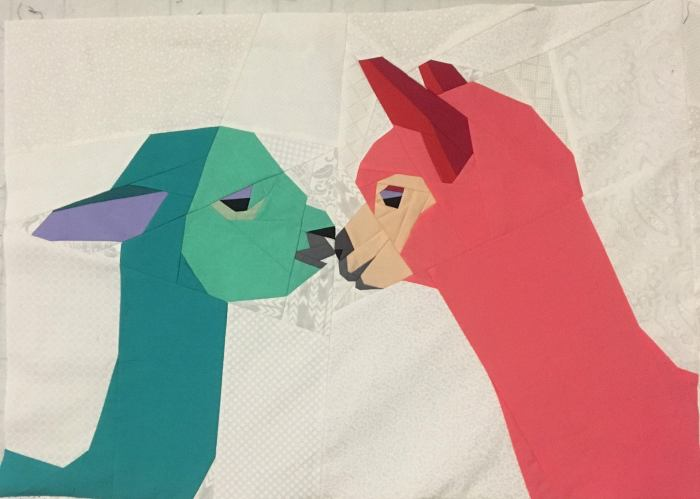 finished paper pieced quilt block of kissing alpacas