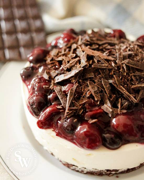 black forest dark chocolate and cherry no bake cheesecake topped with shards of chocolate
