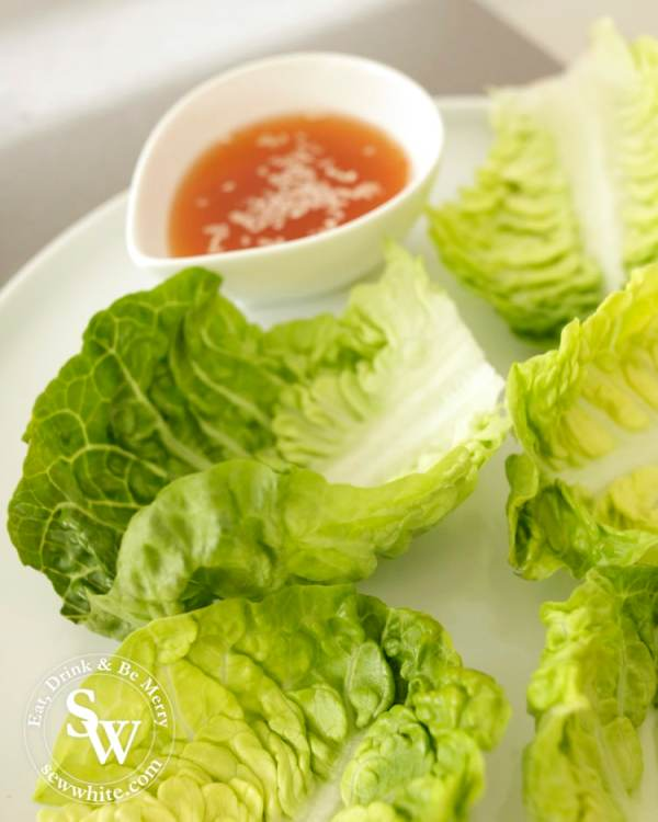 Vietnamese Inspired Beef Salad Bites creating the dish lettuce leaves on a beautiful plate