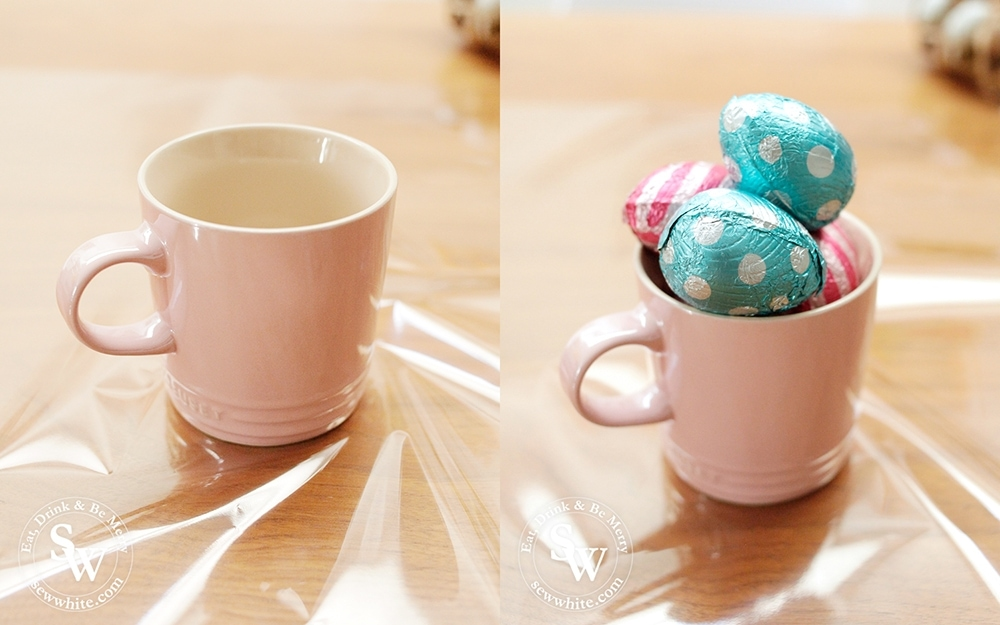 Easter Inspiration Gifts wrapping up Le Creuset cups in cellophane filled with eggs.