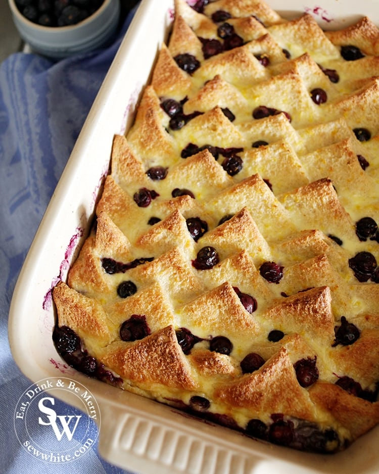 A beautiful golden brown and blueberry studded bread and butter pudding in the Le Creuset Stoneware Heritage Rectangular Dish Medium in Ultra Violet