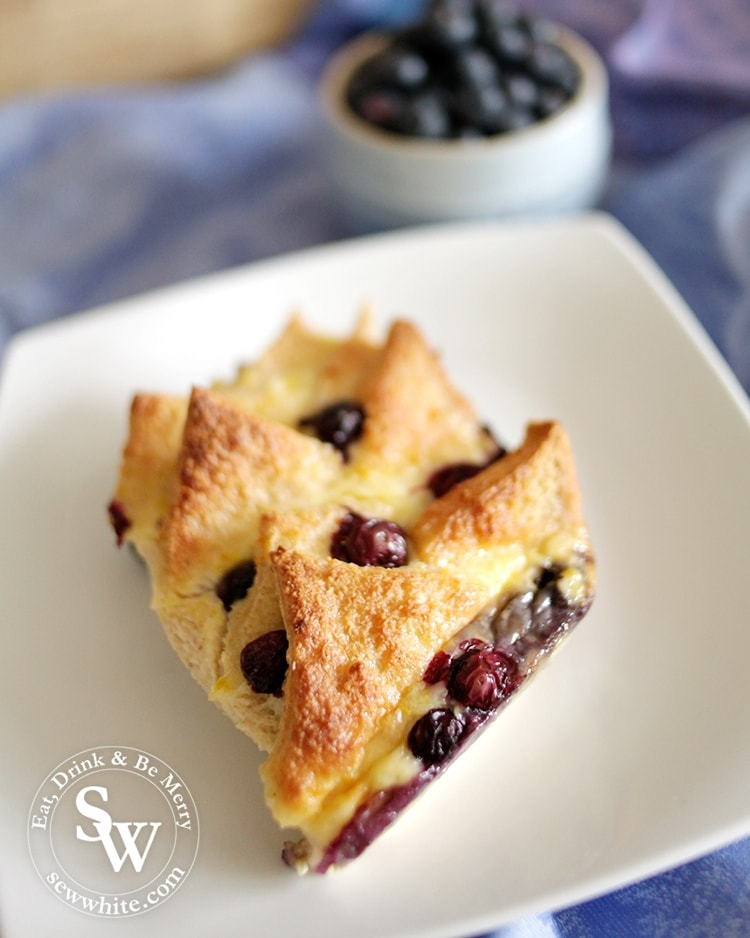 Fresh from the oven a golden brown Blueberry and Lemon Bread and Butter Pudding