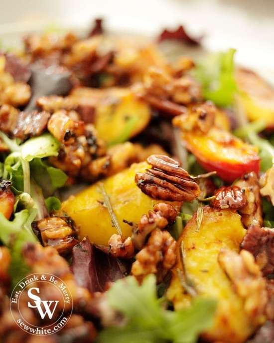 Maple syrup glazed walnuts and pecans on top of the grilled peach salad.