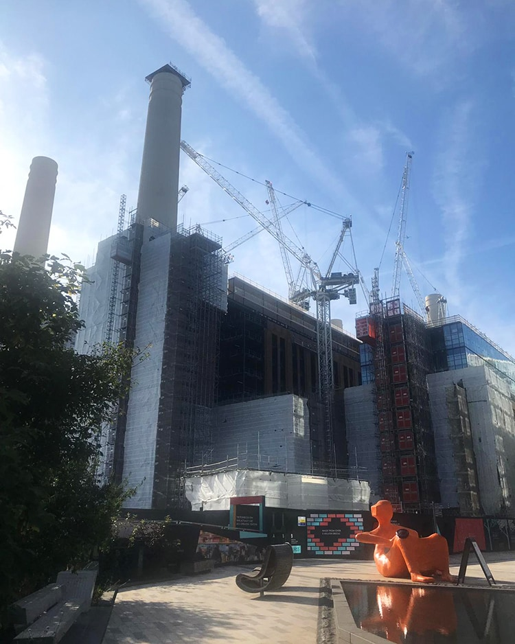 Battersea Power Station nearing completion on a beautiful sunny day.