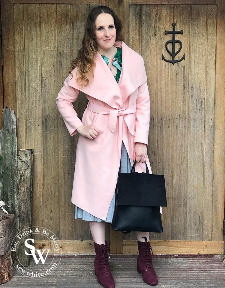 sisley White modelling the lawful london black dahlia bag.
