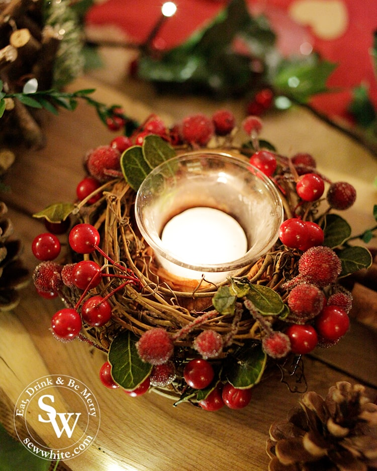 Red and Green Woodland Christmas Table with red berries candle holder.