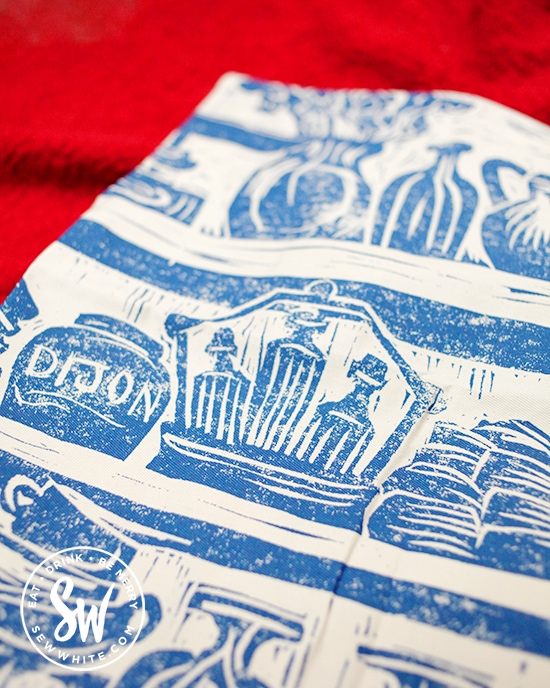 Detail of the lino print apron by Katie Guy