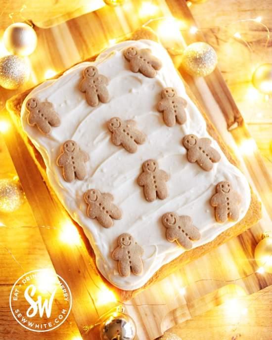 Gingerbread men on a ginger cake