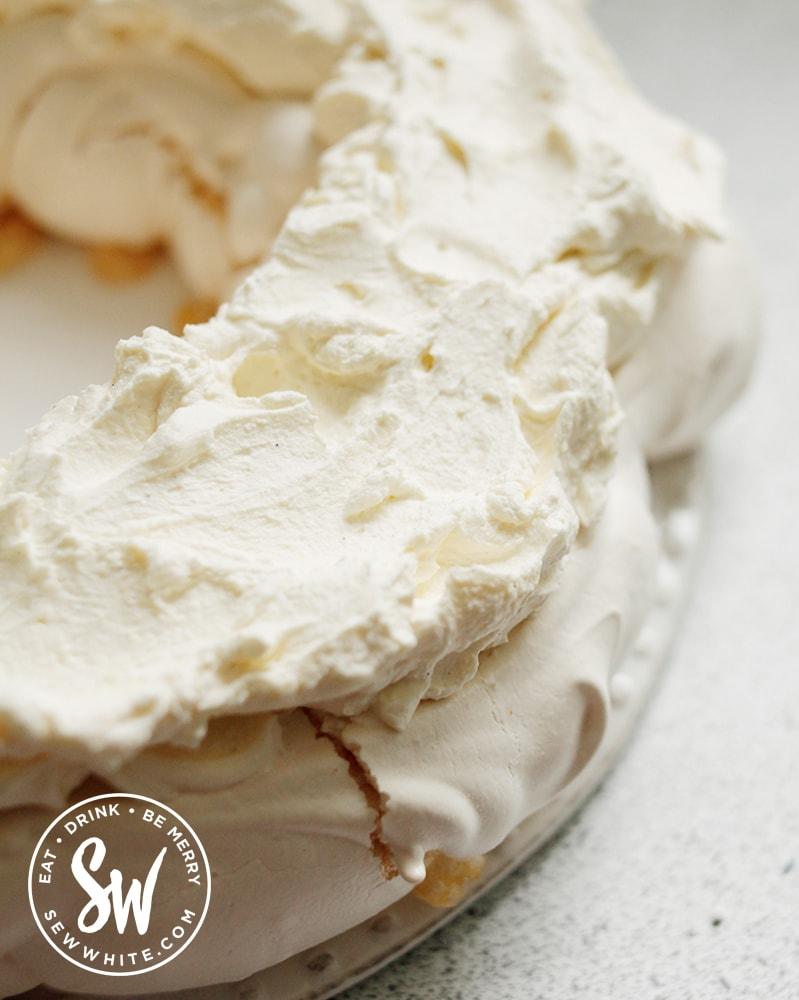adding the cream to the cooked meringue