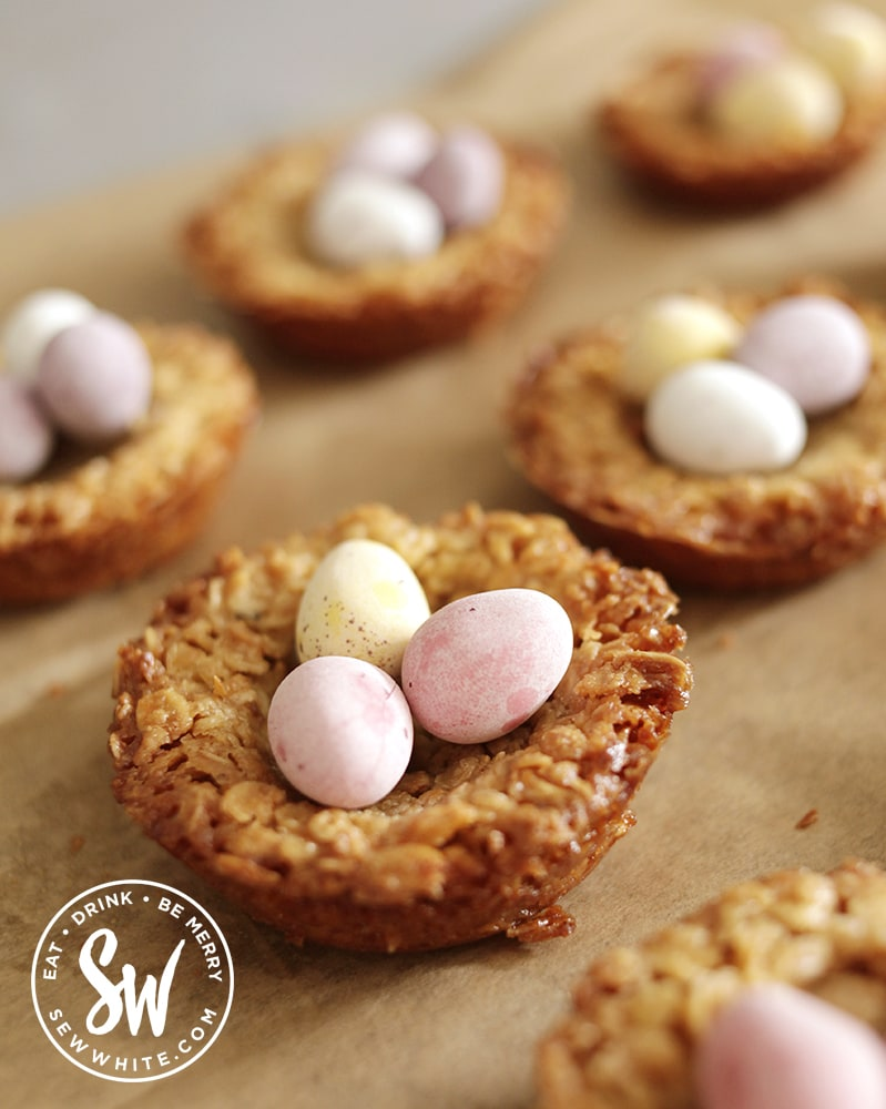 Gold brown soft flapjack recipe  with pastel Easter chocolate eggs