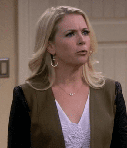 Mel Burke (Melissa Joan Hart) wearing an olive green blazer with contrast black leather sleeves