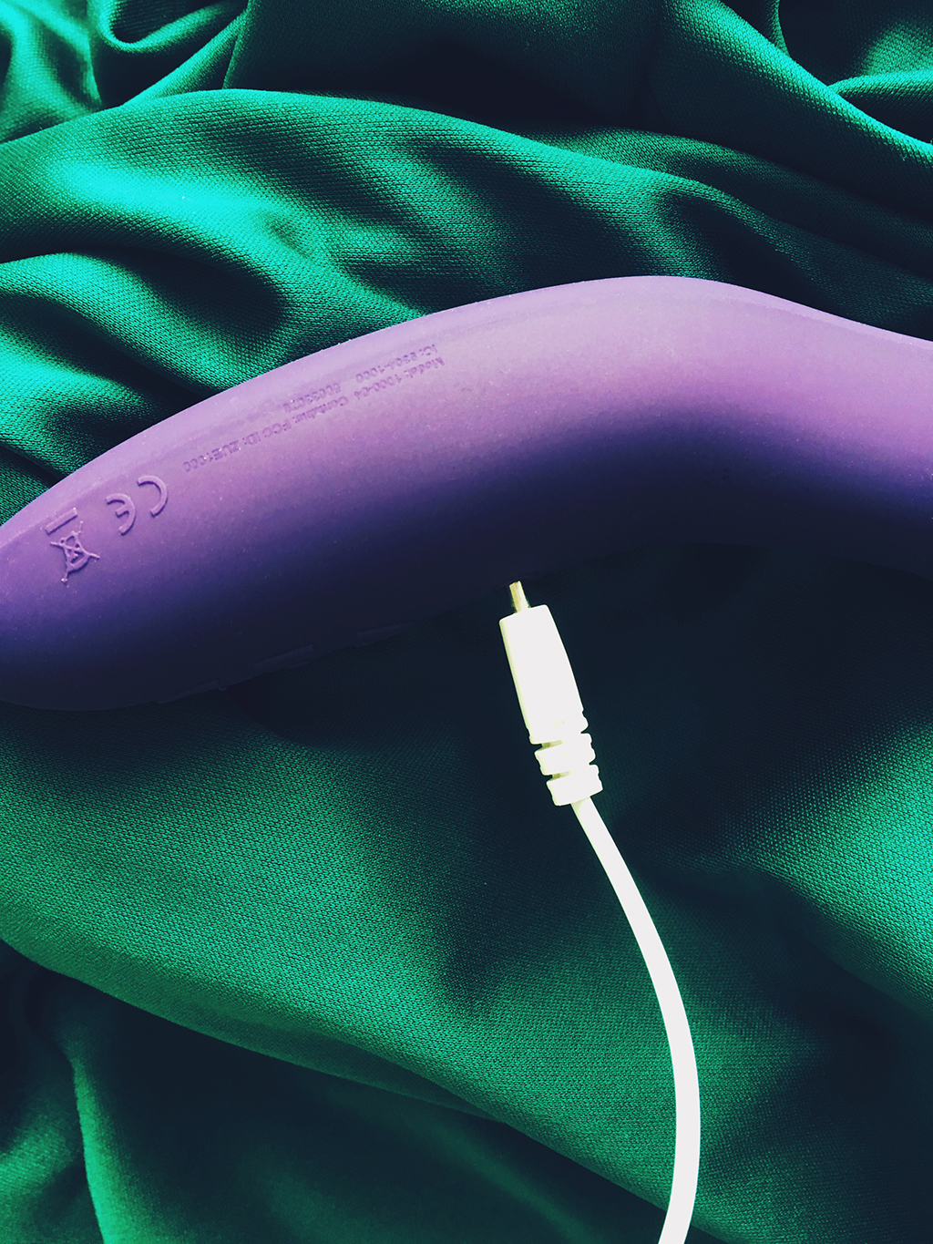 Photo of purple we-vibe rave vibrator showing charging cable being plugged in