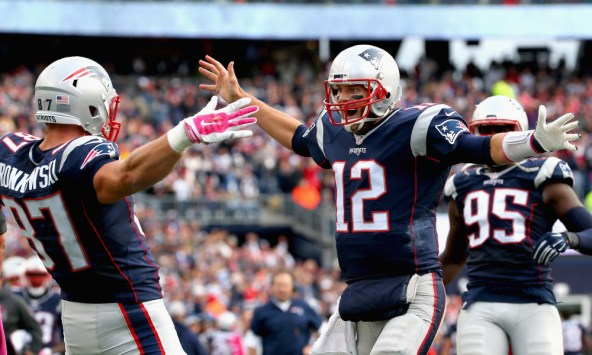 FOXBORO, MA - OCTOBER 25: Tom Brady #12 and Rob Gronkowski #87 of the New England Patriots react after Gronkowski scored a touchdown during the fourth quarter against the New York Jets at Gillette Stadium on October 25, 2015 in Foxboro, Massachusetts. (Photo by Jim Rogash/Getty Images) ORG XMIT: 570172097 ORIG FILE ID: 494235422