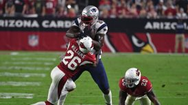 GLENDALE, AZ - SEPTEMBER 11: Cornerback Brandon Williams #26 of the Arizona Cardinals tackles tight end Martellus Bennett #88 of the New England Patriots after a reception as outside linebacker Deone Bucannon #20 of the Arizona Cardinals looks on during the NFL game at University of Phoenix Stadium on September 11, 2016 in Glendale, Arizona. New England won 23-21. (Photo by Ethan Miller/Getty Images)
