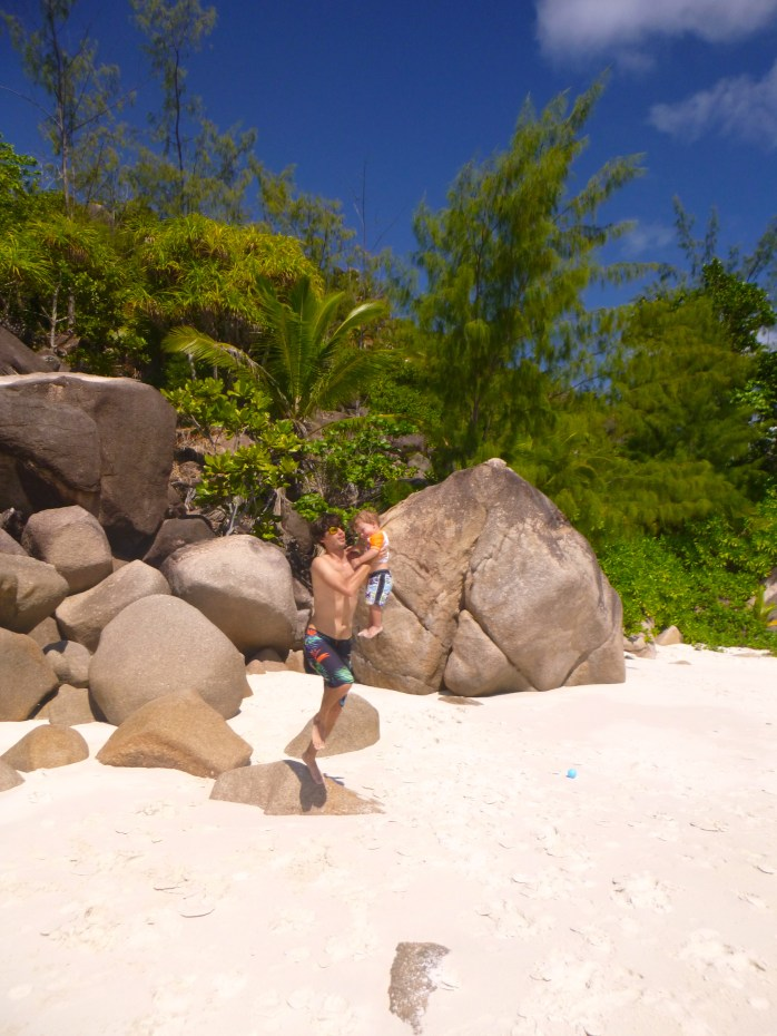 playing on rocks with Daddy Anse Georgette Seychelles