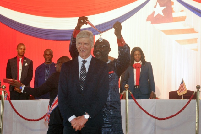 Image result for Liberia's Weah presents honours to former coaches Wenger and LeRoy