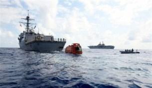 The guided missile destroyer USS Bainbridge tows Maersk Alabama's lifeboat after rescuing Capt. Phillips April 14. - Photo: U.S. Navy Lance Cpl. Megan Sindelar/AP