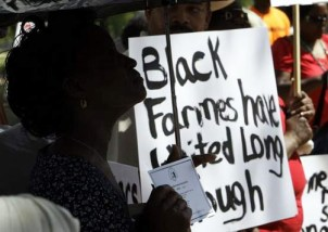 "At their rally April 28, Rep. Artur Davis reassured National Black Farmers Association that Congress and the Obama administration will deliver on a promise to compensate them for past discrimination by the Department of Agriculture. ""I know the heart of the president,"" said Davis. ""I think you're going to like what's going to happen."" The farmer's sign says, ""Black farmers have waited long enough."" Photo: Alex Brandon, Montgomery Advertiser"
