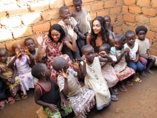 Noella Coursaris and Fatima Najm sing nursery rhymes with children in a one-room, roofless, makeshift all-ages school outside Lubumbashi. – Photo: Creatives Against Poverty