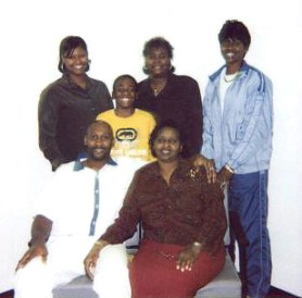 In this 2004 photo taken on death row, Troy Davis is surrounded by his loving family – his mother, Virginia, a nephew and, in back, his sisters, Ebony, Kimberly and Martina.