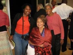 "Bay View Arts Editor Wanda Sabir talks with filmmaker S. Pearl Sharp and artist Riua Akinshegun during the ""Bronzeville"" intermission."