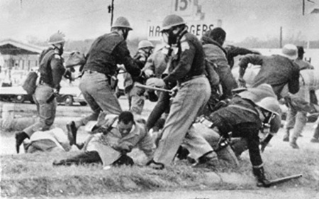 Then SNCC leader, now Congressman John Lewis led the first Selma-to-Montgomery march for voting rights on March 7, 1965, when 600 marchers were attacked by police in riot gear, who fractured Lewis' skull on a day remembered as Bloody Sunday. Before going to the hospital, Lewis appeared before television cameras demanding intervention by President Johnson, who, eight days later, appeared before a joint session of Congress to demand passage of the Voting Rights Act. It was passed Aug. 3, 1965.