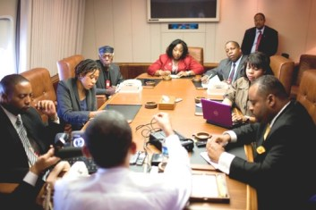 Discussing Black issues on Air Force One with President Obama (back to camera) are, from left, Kevin Chappell, Cynthia Gordy, Herb Boyd, Pamela Gentry, Derek Dingle, April Ryan and Roland Martin.