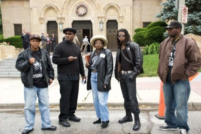 Chairman Fred Hampton Jr. and his POCC comrades prepare to enter the church during the funeral for former States Attorney Edward V. Hanrahan to show their disrespect for his role in ordering the assassination of Chairman Fred Hampton and Defense Captain Mark Clarke of the Black Panther Party. – Photo: Trig