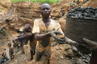 Gold is the symbol of wealth, but no value is placed on the lives of these gold miners, a few of the 20,000 working at the AngloGold Ashanti (AGA) mine in Mongbwalu, Congo. Forced to use cyanide to extract the gold, they earn little but an early grave. Exploitation of African people and resources to feed Western greed has changed little since the days of King Leopold. – Photo: CAFOD