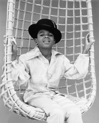 Taken at Michael's very first Motown photo session in 1969, this photo shows his natural cheek bones, almond shaped eyes and his love for hats. – Photo: David Alston's Mahogany Archives