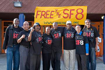At Tuesday's celebration at the Ella Hill Hutch Community Center are, from left, Harold Taylor, Francisco Torres, Richard Brown, Soffiyah Elijah, Richard O'Neal, Hank Jones, Eric Mar and Ray Boudreaux. Supervisor Mar joined the festivities, having co-sponsored the San Francisco Supervisors' resolution to drop the charges. – Photo: Scott Braley