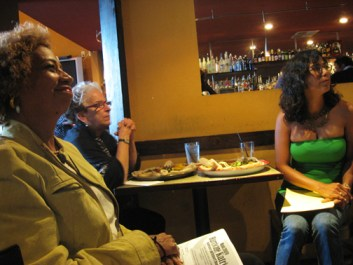 Kathryn Takara, featured poet, Kathy Sloan, photographer, and Karla Brundage, co-host with Wanda Sabir, enjoy the Maafa 2009 Hurricane Katrina Fundraiser and Reportback Aug. 30. - Photo: Wanda Sabir