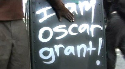"Ever since the cold blooded, videotaped murder of Oscar Grant at 2 a.m. New Year's Day by BART cop Johannes Mehserle, Oaklanders have covered the city with the message, ""I am Oscar Grant!"" - Frame from the film ""Operation Small Axe"""