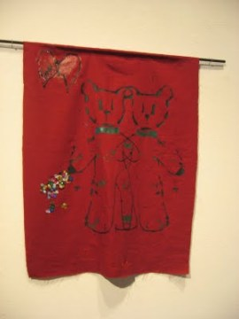 """Wanda describes this piece at the California College of the Arts exhibit as a """"tapestry with teddy bears and sequins and stitching … for children who'd died or been victims of violence. The piece on red felt was so lovely and so current as just this week a child was hit and killed by a car which kept going after impact."""" - Photo: Wanda Sabir"""