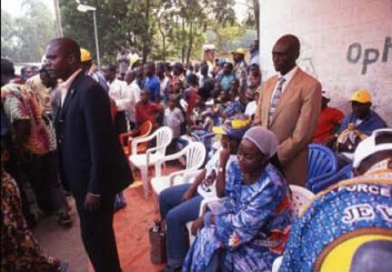 Janet Kabila promises schools and roads to rural Congolese villagers in three years at an election campaign rally in Bas Congo in July of 2006. – Photo: Keith Harmon Snow