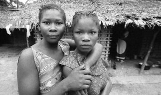 Two young women in a remote village in Equateur province. The average Congolese citizen is innocent of all involvement in war and plunder, never had much of anything for consumer goods, and retains a lovely sense of self, rich with compassion, dignity, truth and courage. These are the victims of the unholy Western warfare alliances in Central Africa. – Photo: Keith Harmon Snow
