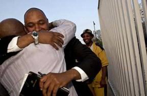 Aaron Patterson bonds out fellow torture victim Nathson Fields.