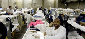 "To lock up these men – this is a prison gym-turned-""dormitory"" in Sacramento – many of them fathers, money is being drained out of education and health care for their children, who are denied a father and breadwinner. Free 'em all! – Photo: Max Whittaker, New York Times"