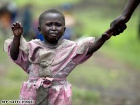 """Imagine being a little child torn from your home, your roots by a war for the wealth that is your birthright. """"The Congo's so poor because it's so rich,"""" raps Congolese-American Omekongo in his song, """"Welcome to the Congo,"""" at http://www.sfbayview.com/2008/welcome-to-the-congo/. – Photo: AFP/Getty Images"""