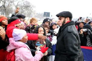 Black Enterprise founder Earl G. Graves shakes hands on the National Mall during the inauguration of President Barack Obama. – Photo: Lonnie Major
