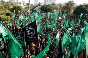 Thousands of Palestinians attend a rally organized by Hamas in Gaza City days after Israel declared a unilateral ceasefire on Jan. 20. – Photo: Mohamed Al-Zanon, MaanImages