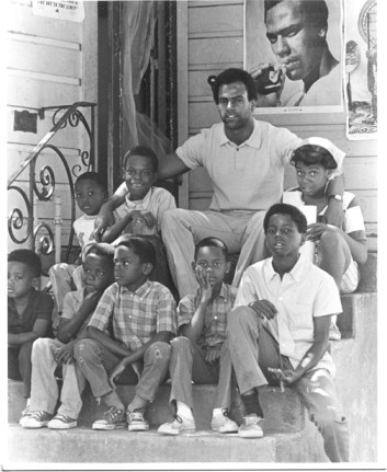 "Huey often visited the Panther schools and breakfast programs, and the children loved him. In his 1980 doctoral dissertation, he wrote: ""The FBI was most disturbed by the Panthers' survival programs providing community service. The popular free breakfast program … was … a particular thorn in the side of J. Edgar Hoover. Finding little to criticize about the program objectively, the Bureau decided to destroy it."" – Photo: Ducho Dennis"