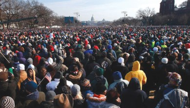 """At the Jan. 20 inauguration of President Barack Hussein Obama, the """"star that shone brightest was the People,"""" says Mumia, """"by the millions. Faces beamed warmth and excitement, seemingly ignoring the frigid temperatures."""" At least 1.8 million people came from across the country and across continents to see the first Black U.S. president. – Photo: Mario Tama, Getty Images"""