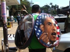 A vendor sells Obama wheel covers on Oginga Odinga Street in Kisumu, Kenya, on Jan. 19, the day before President Obama's inauguration. – Photo: Fred Ooko, AP