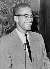 Malcolm X in 1964, flashing the infectious smile that drew people to him