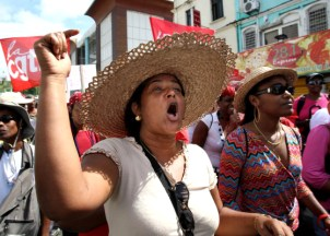 """In Martinique, thousands of Black protesters marched Friday, Feb. 13, through the capital, chanting slogans against """"bekes"""" — the descendants of colonists and slave holders, who comprise only 1 percent of the population but own nearly all industries. """"Martinique is ours, not theirs!"""" they shouted. – Photo: AFP/Getty Images"""