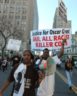 Among those marching down 14th Street after Mehserle's bail hearing is Minister of Information JR, one of the Oakland 100, the only journalist charged in the rebellions following the execution of Oscar Grant. – Photo: Bill Hackwell