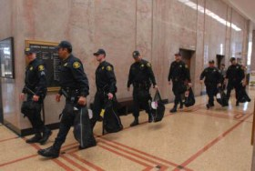 Alameda County Sheriff deputies leave the courthouse with their riot gear after a judge granted bail to former BART Police Officer Johannes Mehserle on Friday. Photo: Jose Carlos Fajardo, San Jose Mercury News