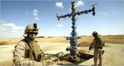 Brig. Gen. John R. Allen, left, stands guard at an oil and natural gas well in the desert of Iraq's western Anbar Province, near Syria, where new deposits have recently been found. U.S. control of Iraqi natural gas as well as oil is a major factor driving the war. - Photo: Robert Nickelsberg, Getty Images, for The New York Times